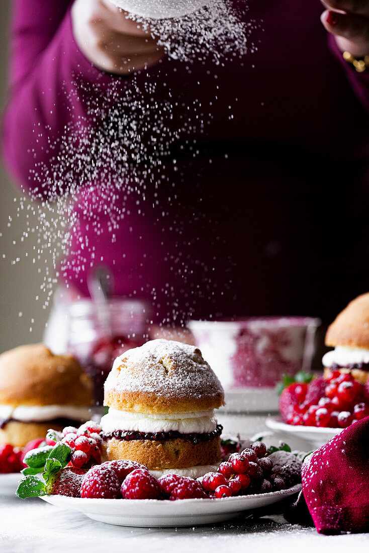 Victoria Sponge Cake with raspberry jam and whipped cream