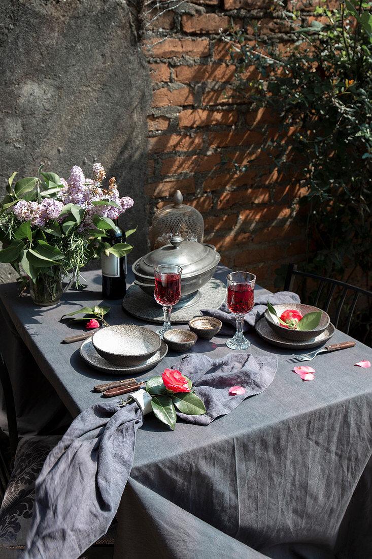 Mediterranian Table cloth with whole ham jamon serrano leg, baked artichokes and red wine