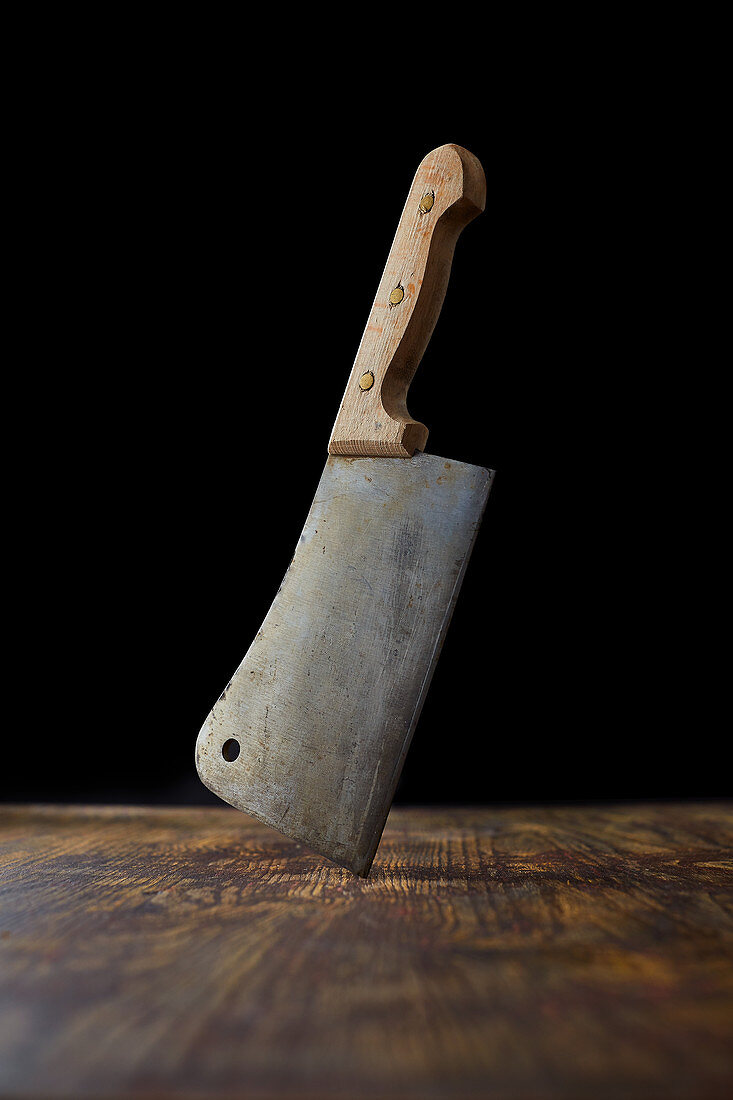 A cleaver on a wooden background
