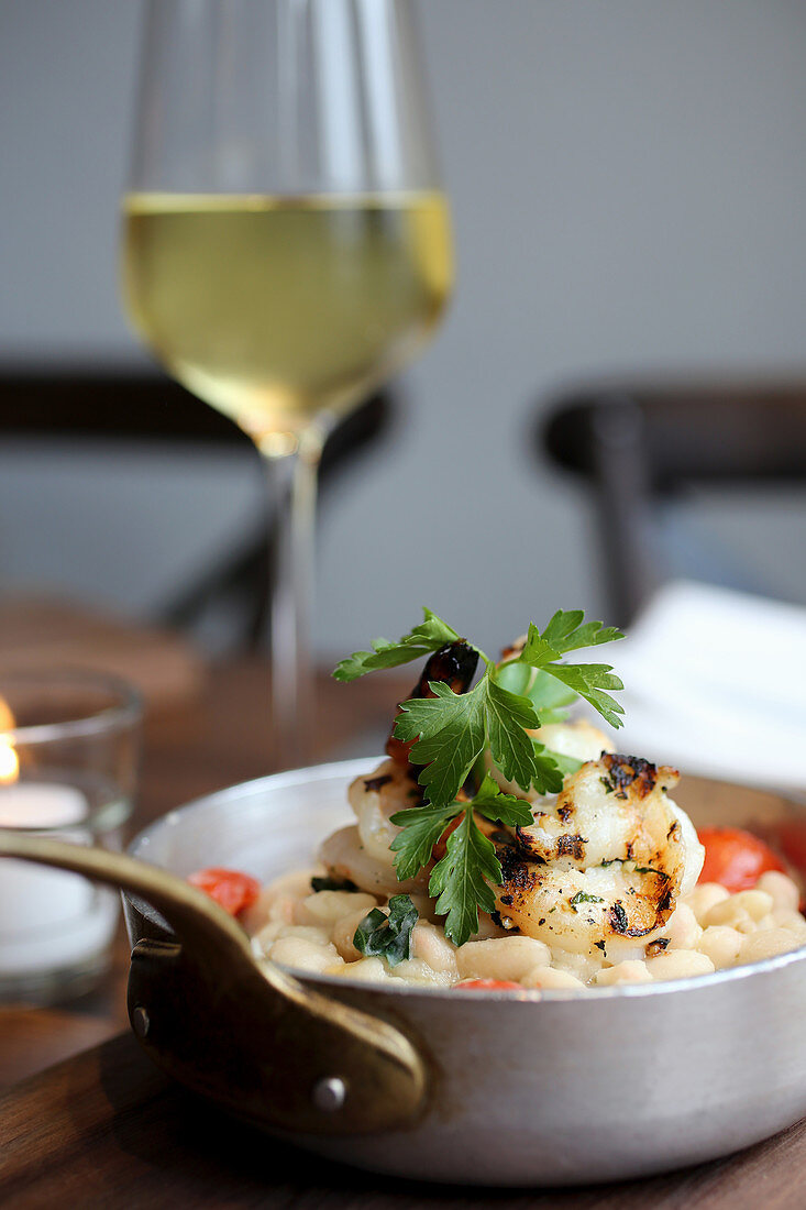 Grilled shrimp over sautéed cannellini beans