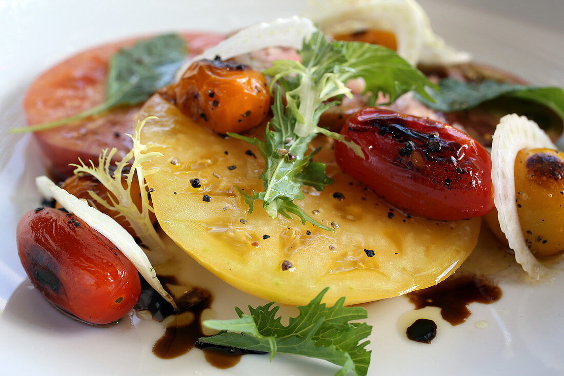 Heirloom tomato salad with fennel and mesclun