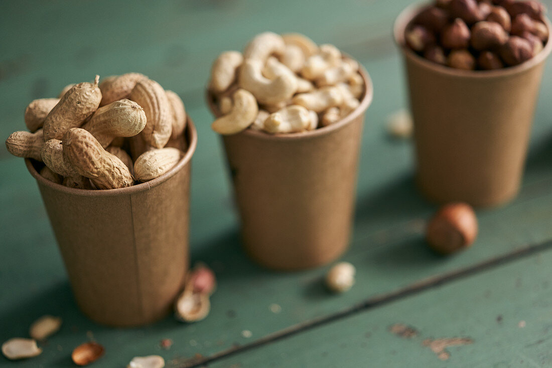 Peanuts, cashews and hazelnuts in cups