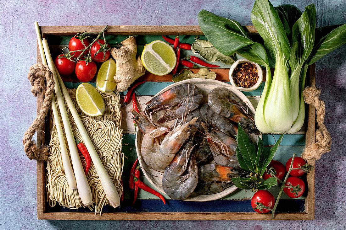 Raw prawns shrimp with asian noodles, cocnut milk and vegetables