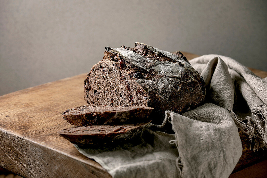 Sliced fresh baked artisan round homemade chocolate and cranberries rye bread