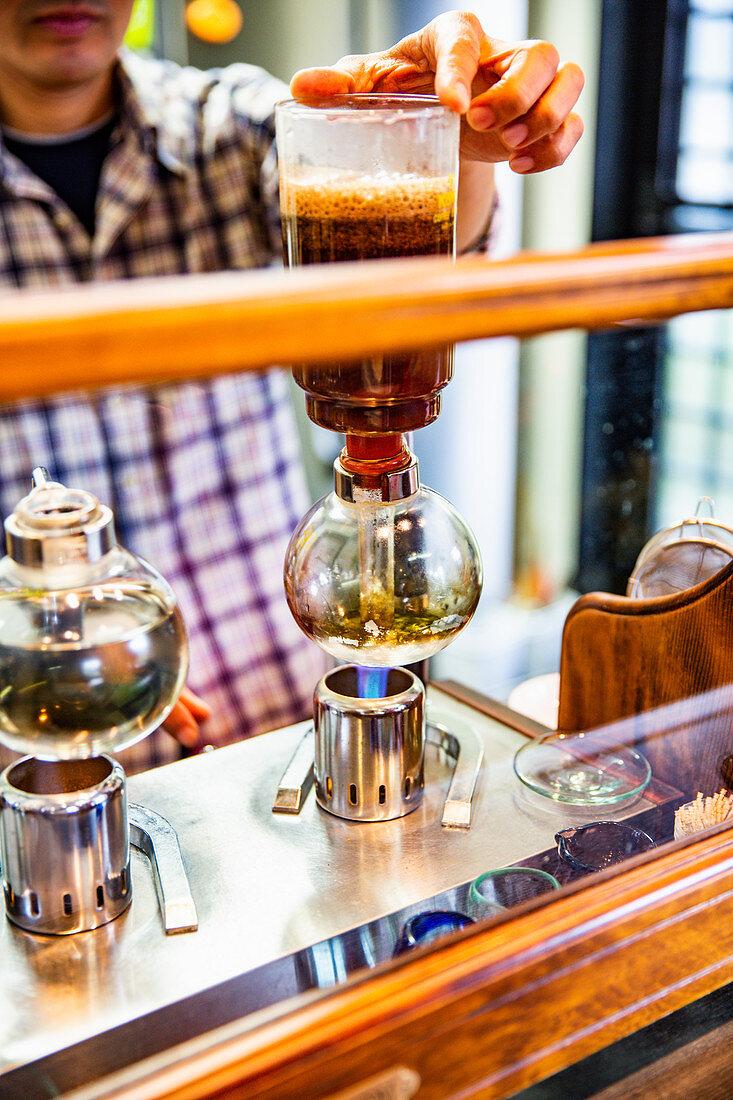 Man brewing japanese coffee