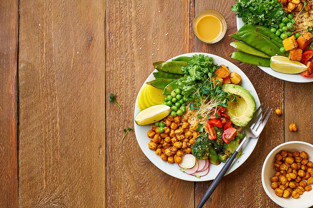 Healthy vegetarian lunch bowl with avocado, chickpeas, quinoa, microgreens and vegetables