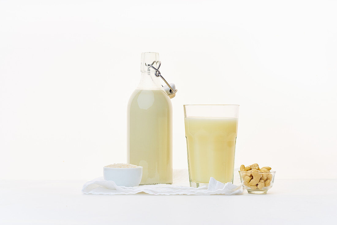 Rice milk and cashew milk in a flask and a glass