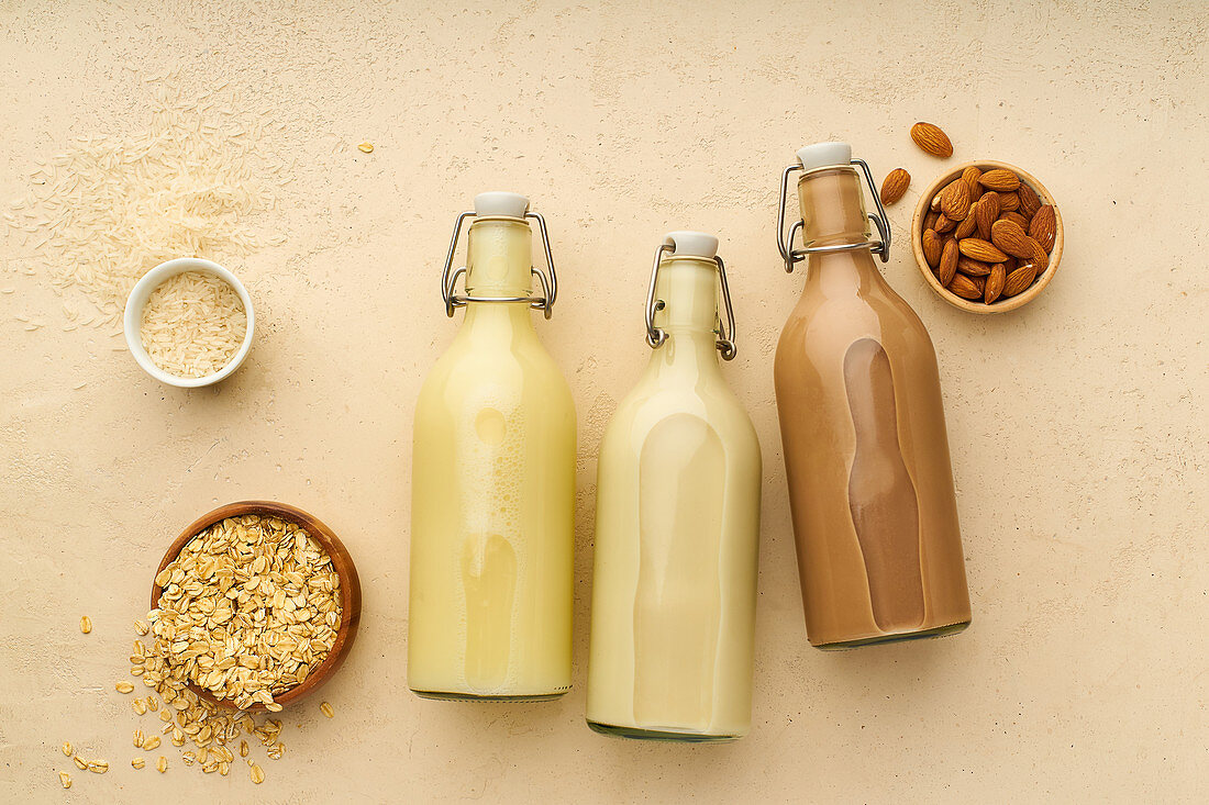 Oat milk, rice milk and chocolate almond milk in flip-top bottles
