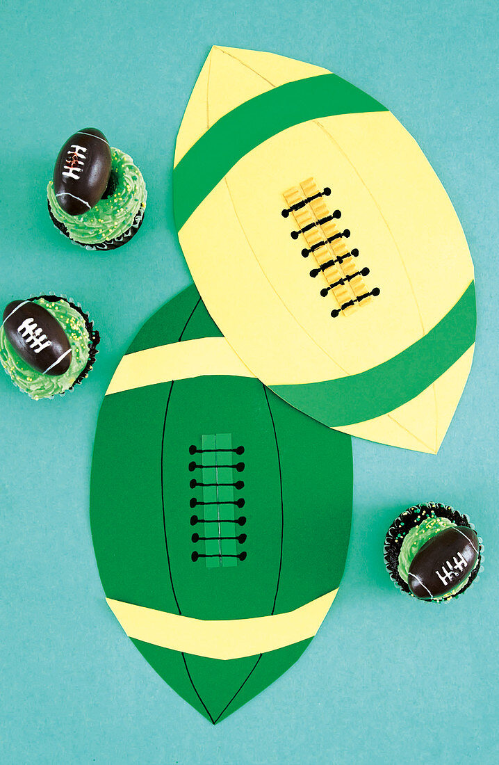 Cupcakes and paper decorations for rugby-themed party