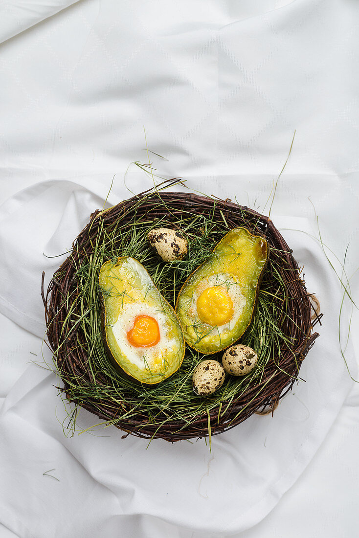 Avocado with baked eggs in an Easter basket