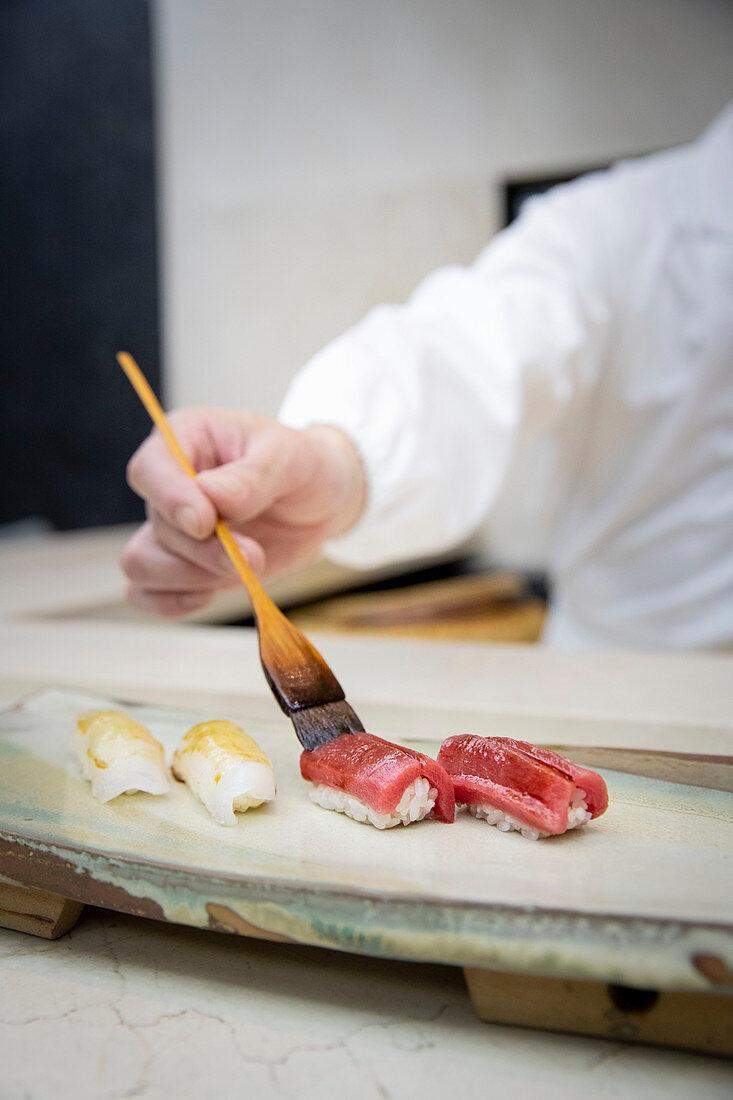 Nigiri sushi being made
