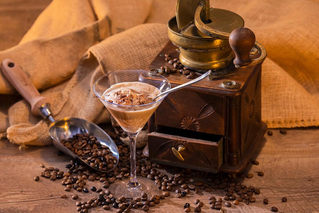 Coffee grains and ice cream near grinder