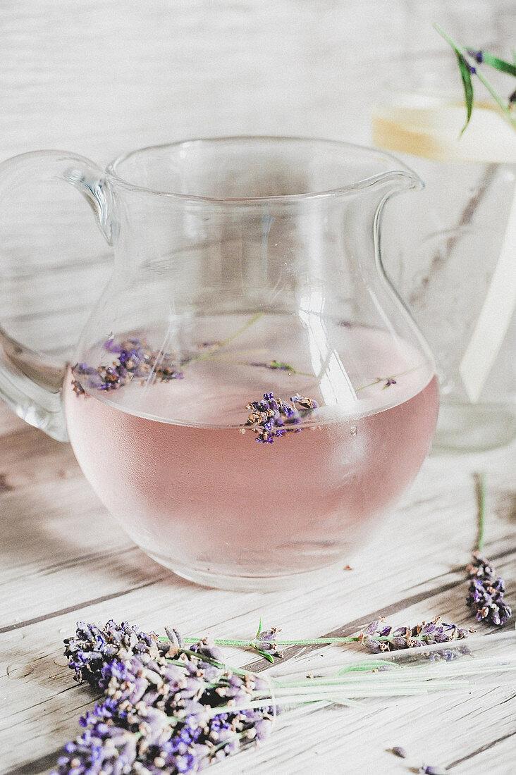Homemade lavender lemonade in a glass jug