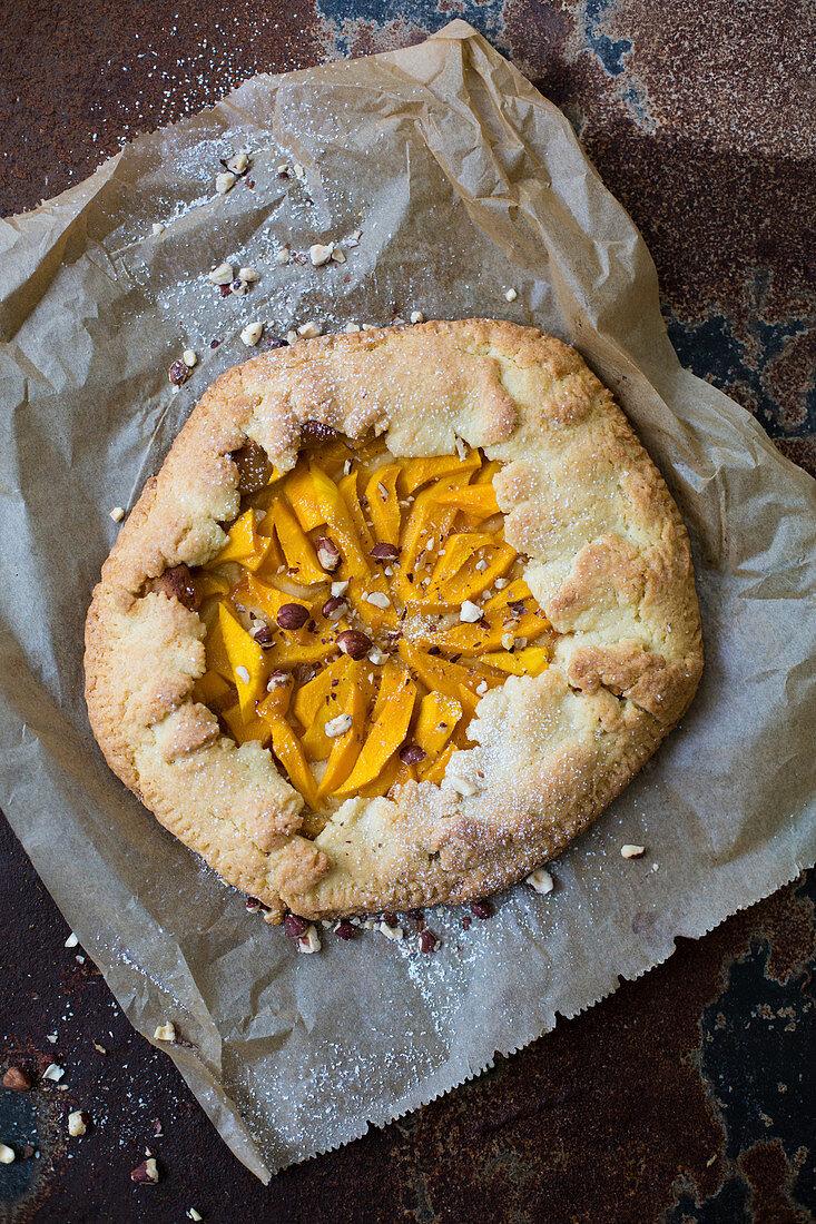 Mango tart on a piece of baking paper