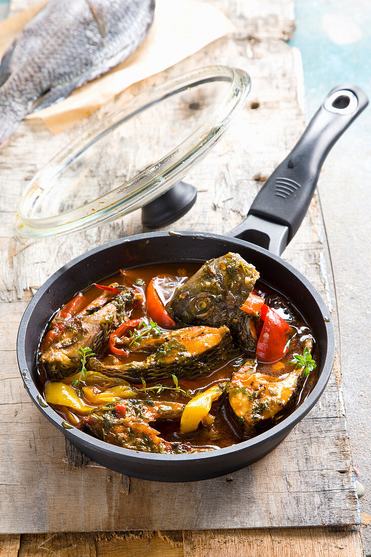 Moroccan-style fried fish with peppers and herbs