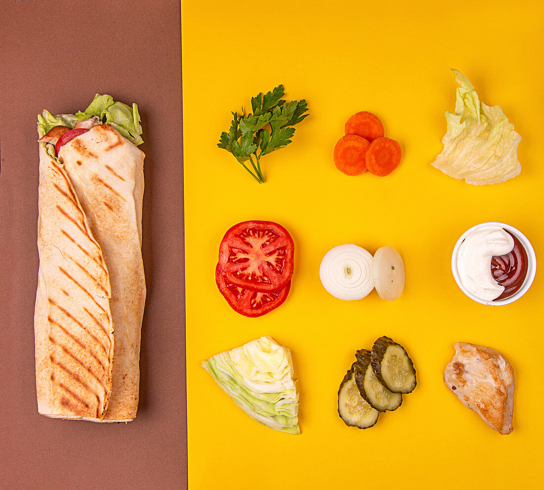 Turkish fastfood doner shawarma roll with meat and vegetables