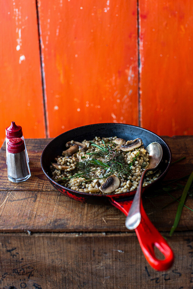Barley risotto with mushrooms and herbs