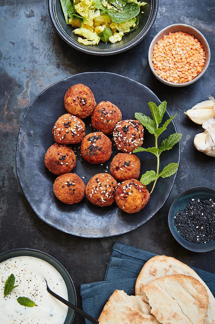 Fried lentil balls with a lemon and yoghurt dip