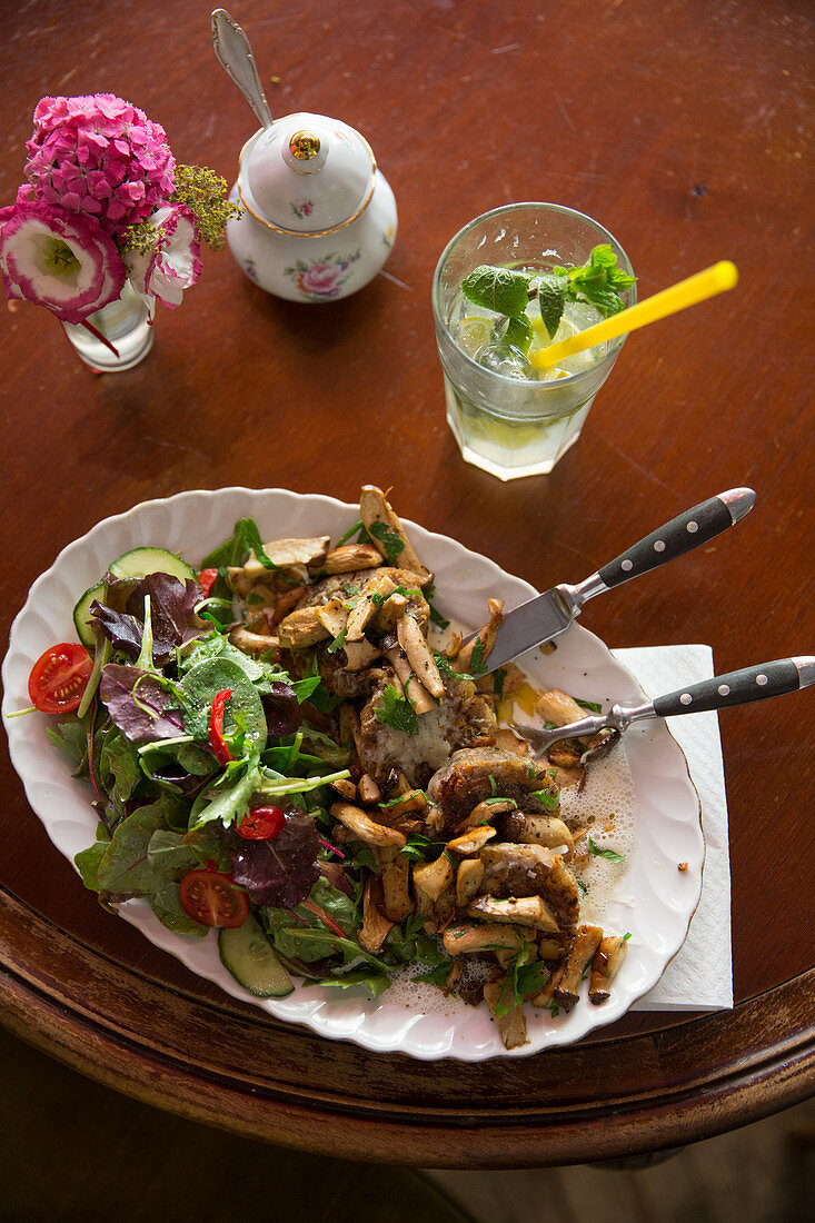 Fried cauliflower and mushrooms with a side salad