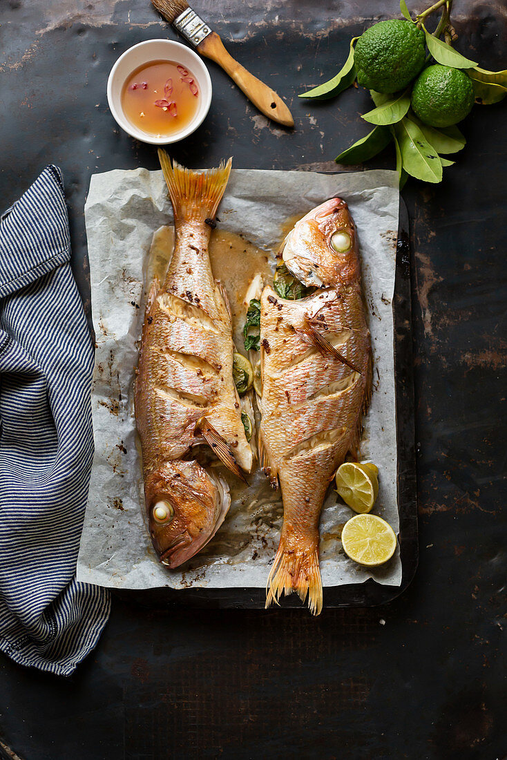 Oven-baked fish with kafir limes, lemons and chilli sauce