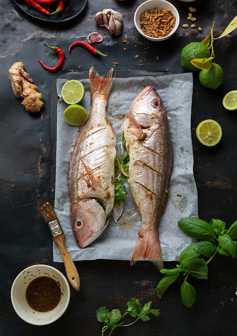 Whole raw fish with ingredients