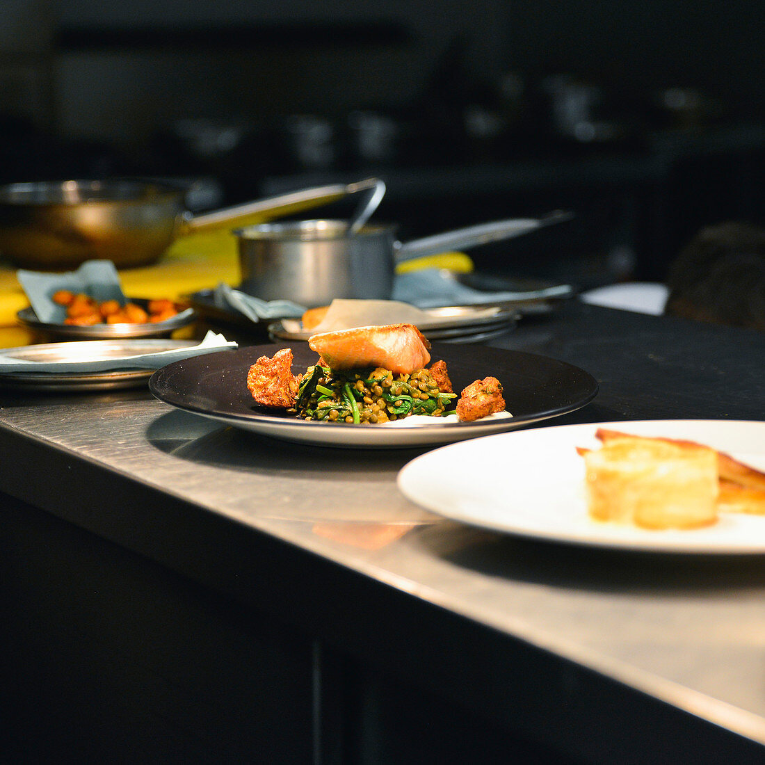 Plated food waiting for service in restaurant kitchen