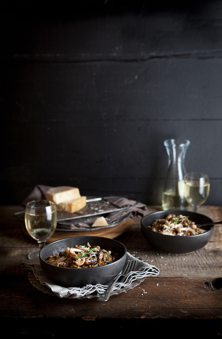 Mushroom risotto with Parmesan served with white wine