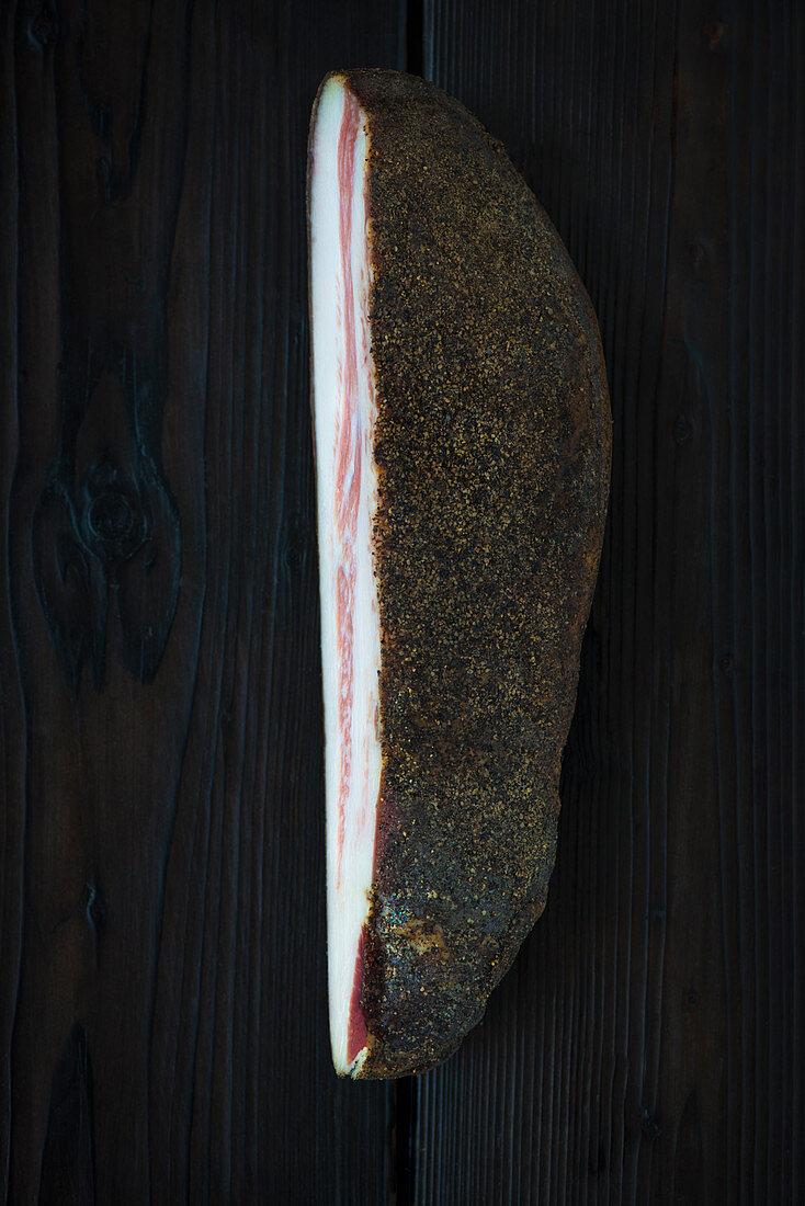 Guincale on burnt wood