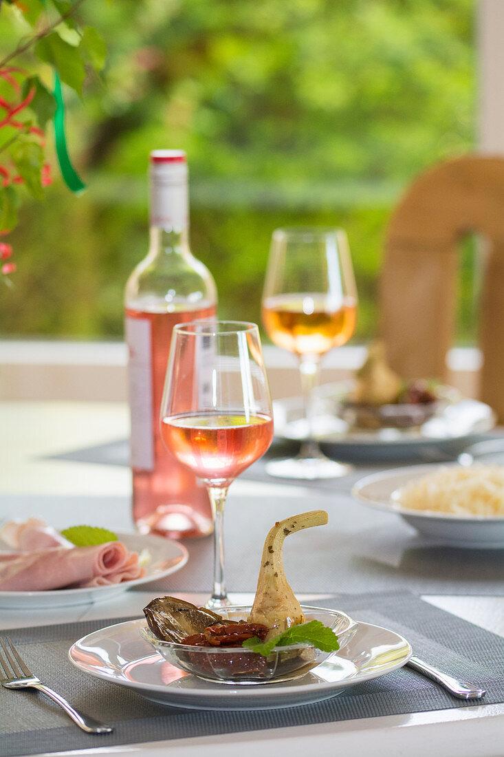 Italian antipasti setting with rosé