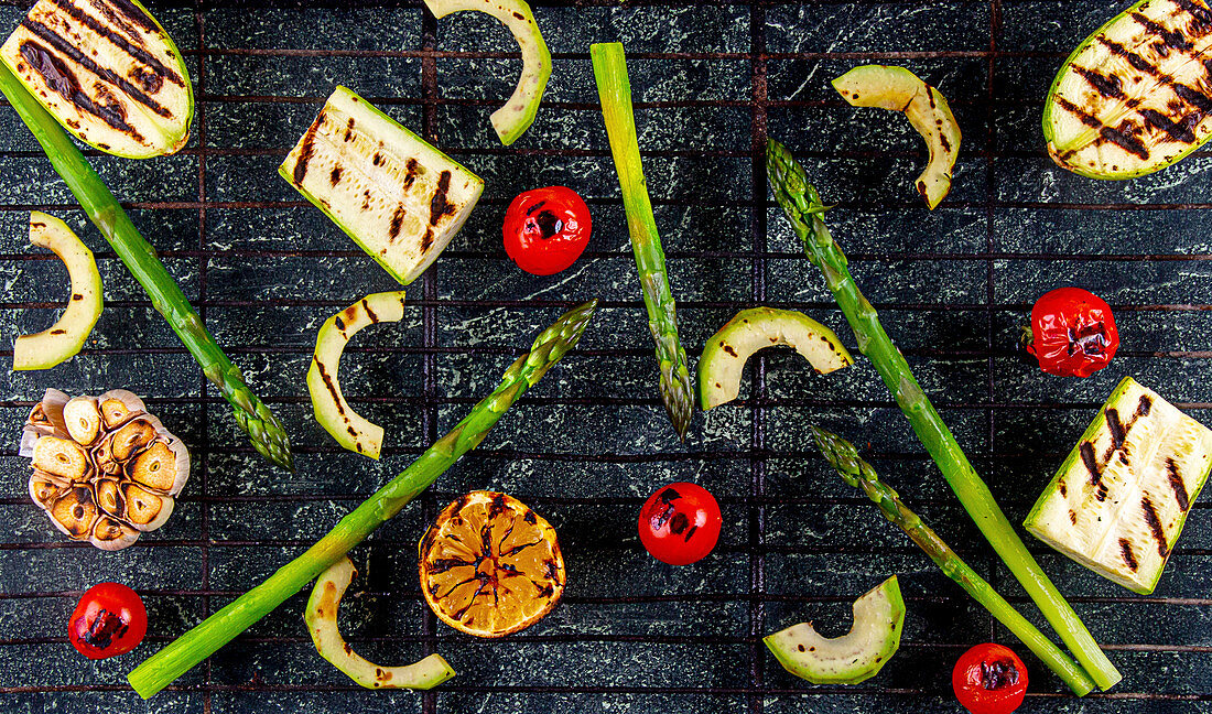 Grilled organic vegetables - green avocado, tomato cherry, avocado, courgette, garlic and lemon