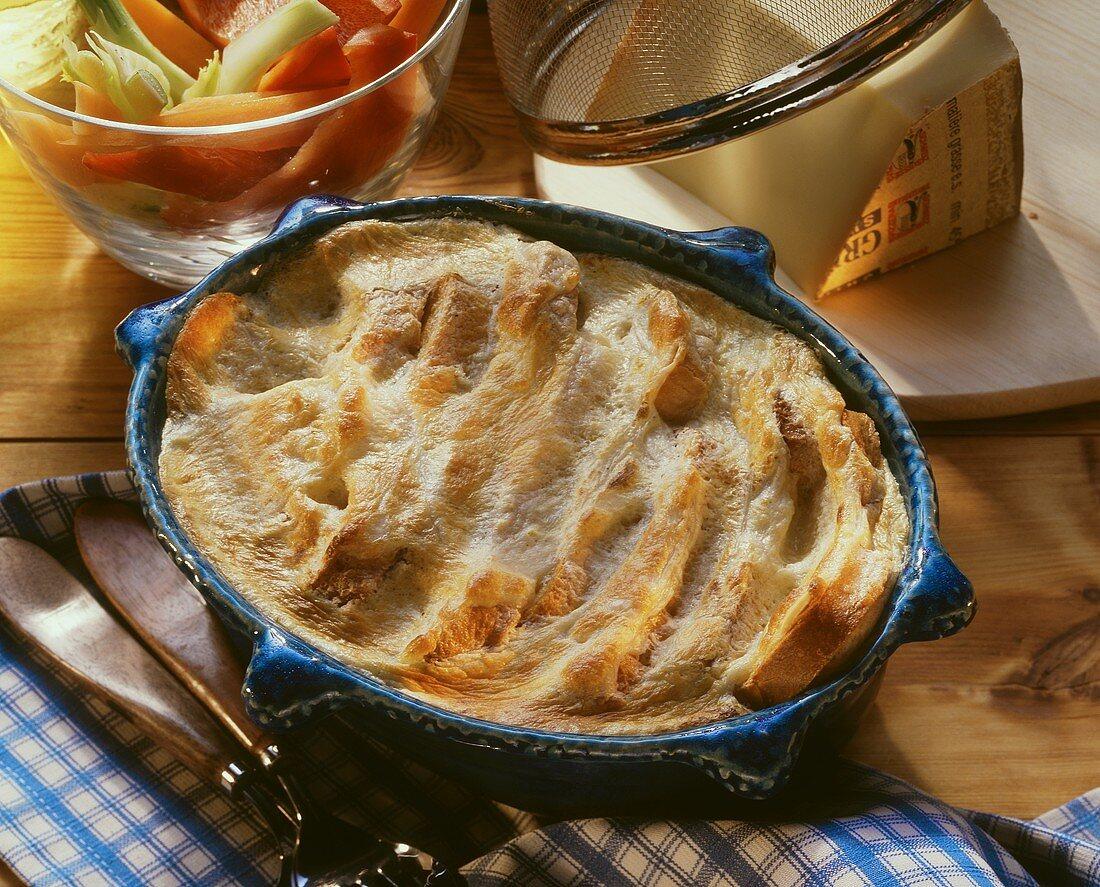 Swiss cheese souffle in souffle dish