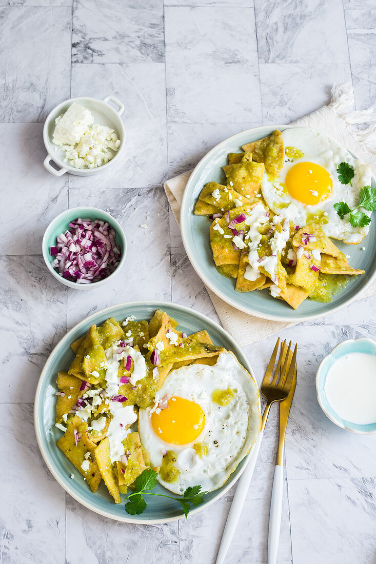 Chilaquiles Verdes - Mexican fried corn chips with tomatillo sauce