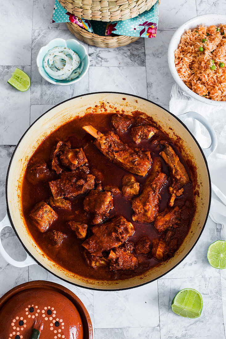Small pork ribs cooked with adobo sauce and served with rice, tortillas, pickled onions and lime
