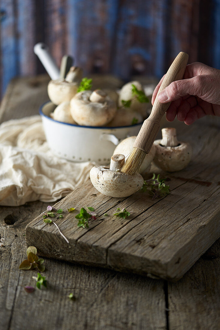 Champignons and a champignon brush on a wooden board