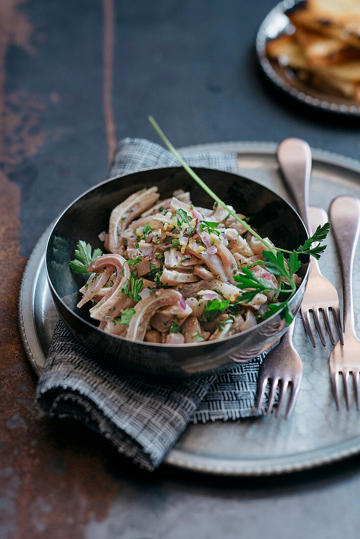Pig ear salad with lemon and parsley