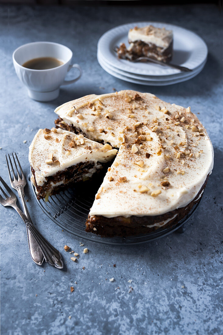 Gluten-free carrot cake with philadelphia frosting and almonds