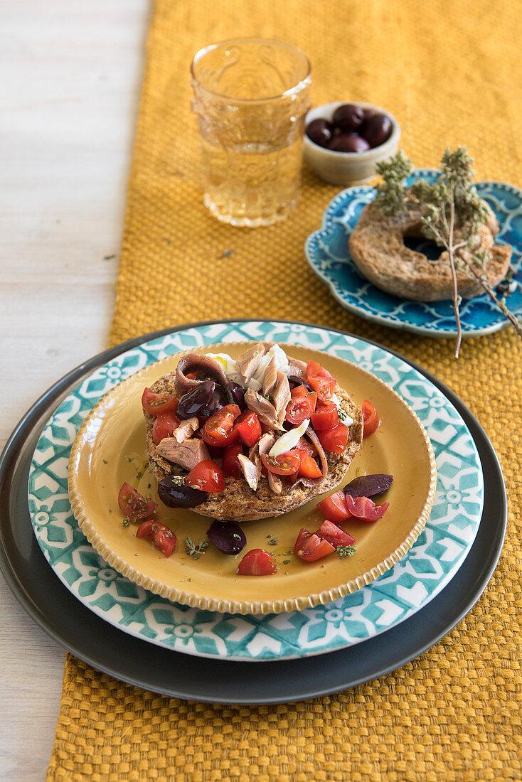 Friselle with tuna and tomato salad and mozzarella