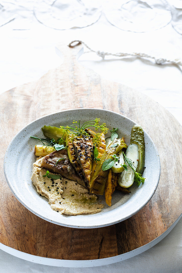 grilled zucchini over hummus with just fermented cucumbers