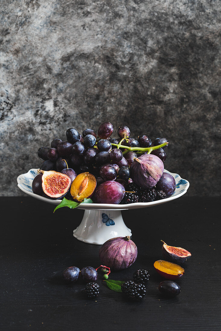 An arrangement of grapes, figs and plums