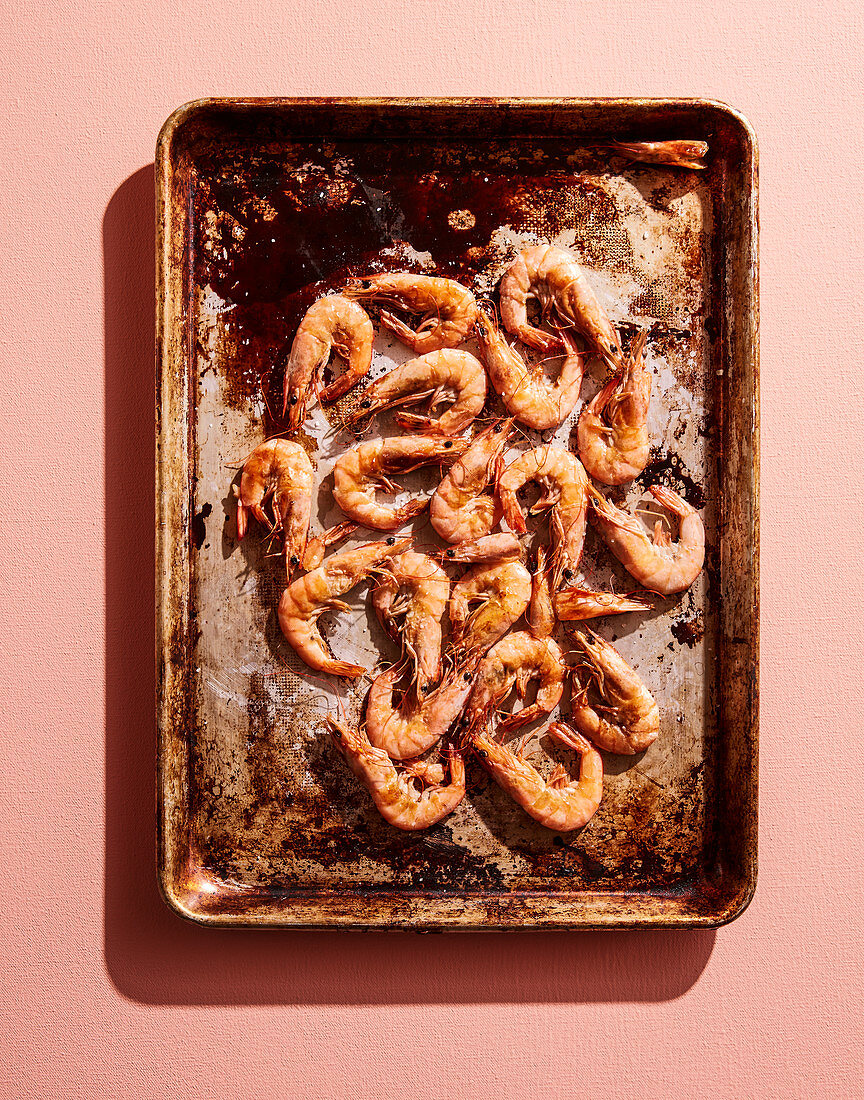 Roasted shrimps on an old baking tray