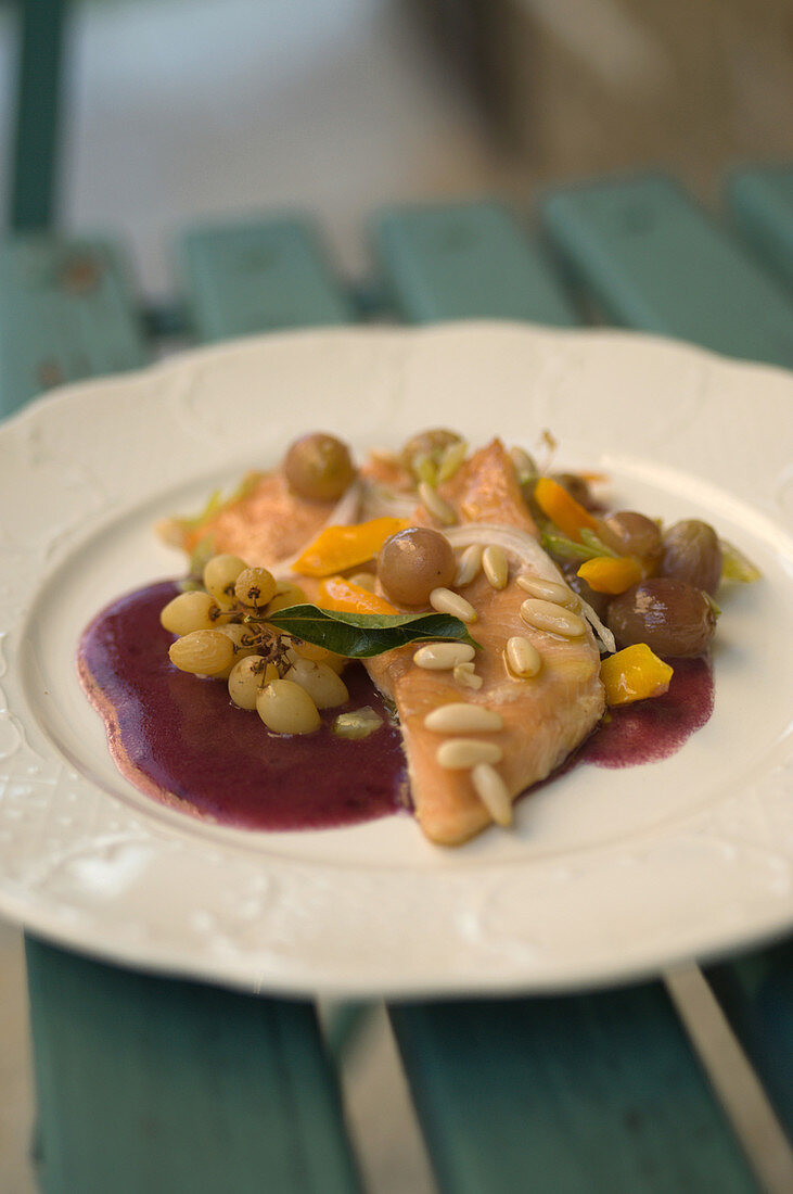 Trout fillet with grapes and pine nuts on dolcetto sauce