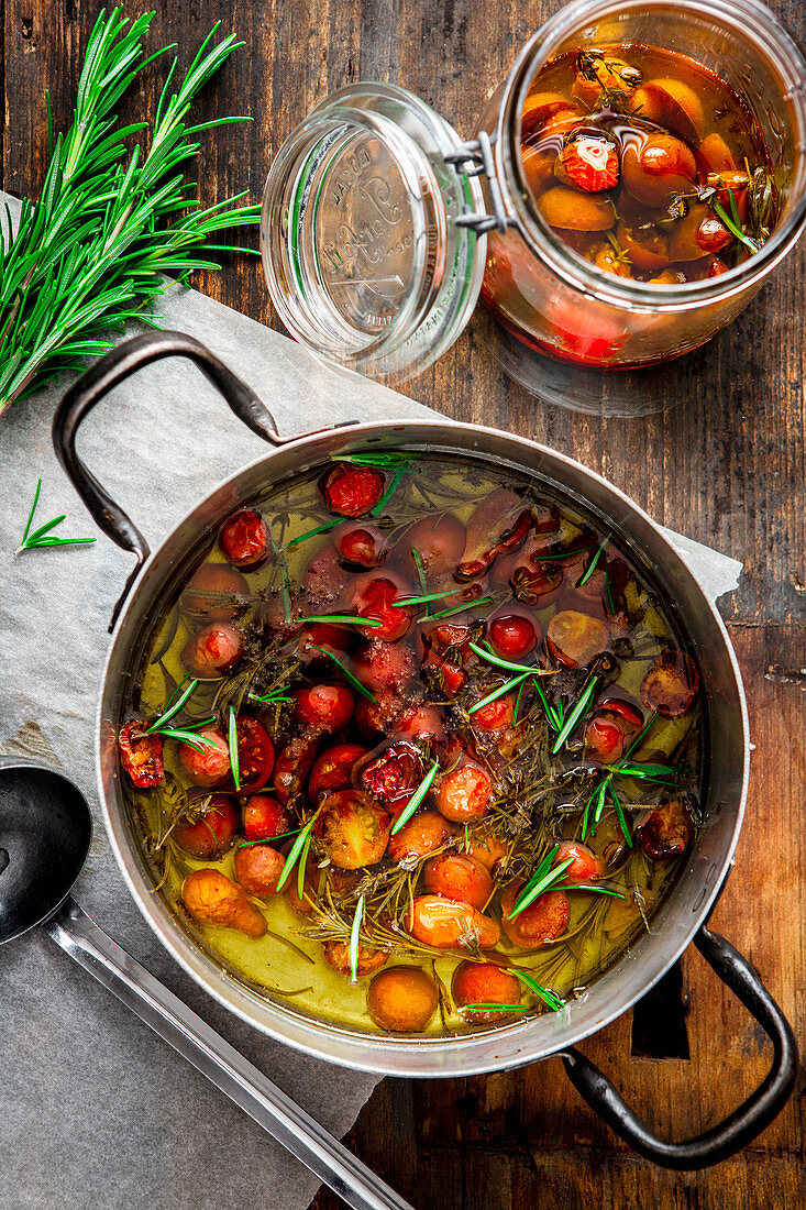 Tomato confit in a pan and a jar