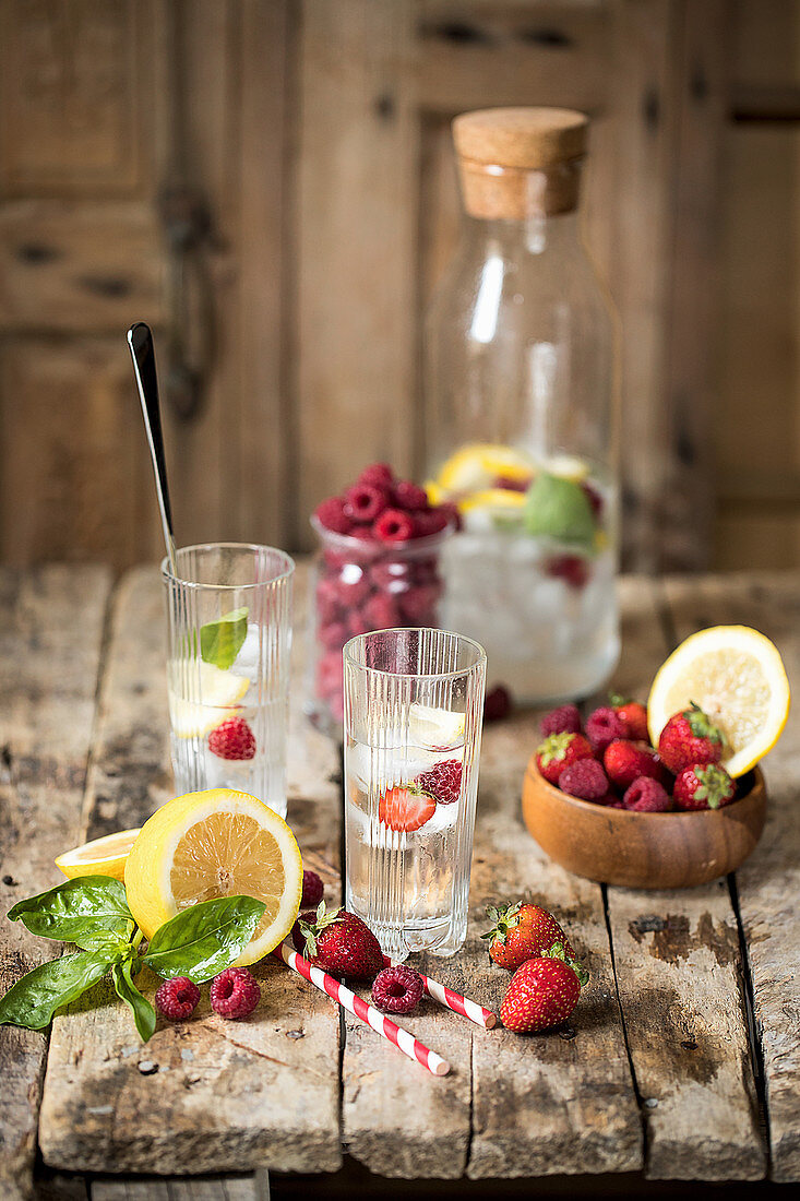 Flavoured water with berries, lemon and ice cubes