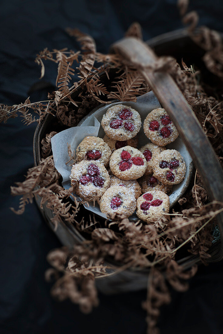 Homemade almond flour and dried cranberry cookies in a rustic basket