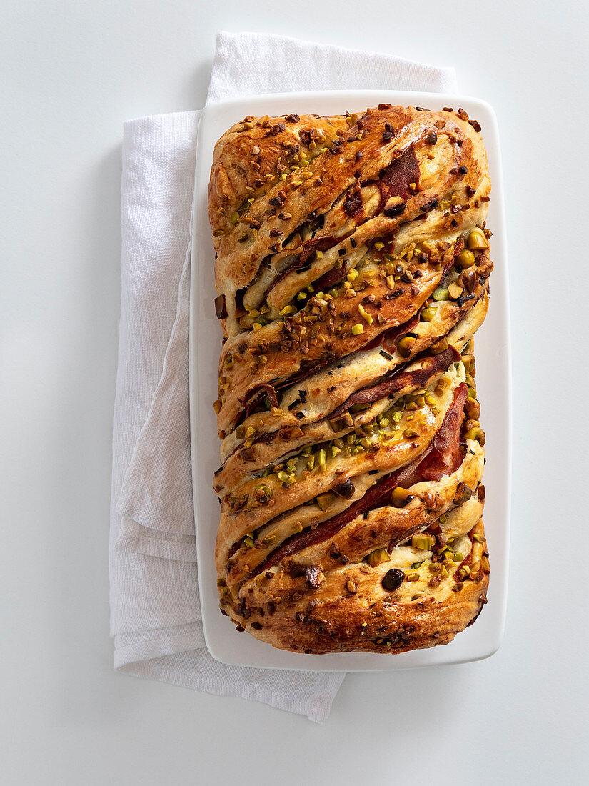 Pistachio and mortadella bread plait