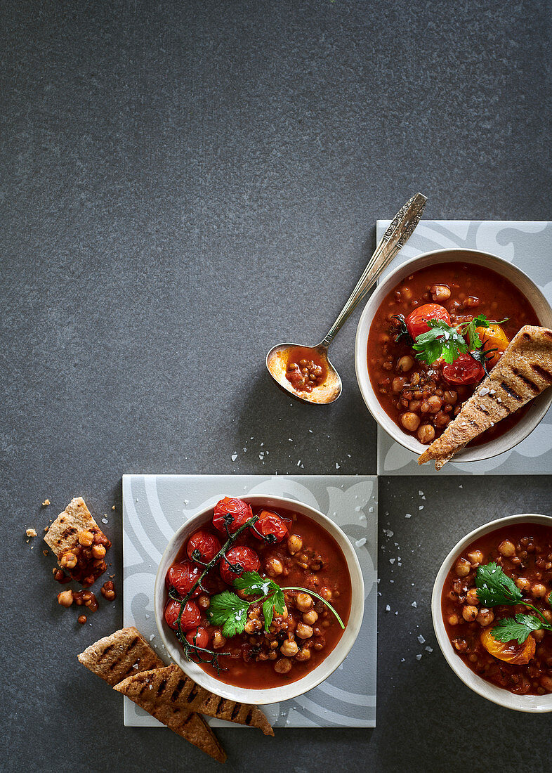 Chilled moroccan chickpea, lentil and tomato soup with crispy pita strips