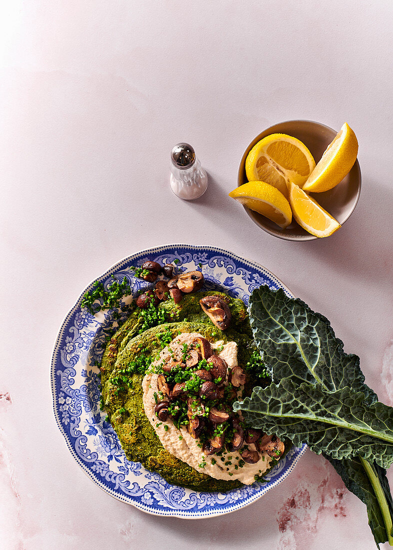 Green spinach 'pancakes' with cashew 'cream cheese' and pan-fried mushrooms