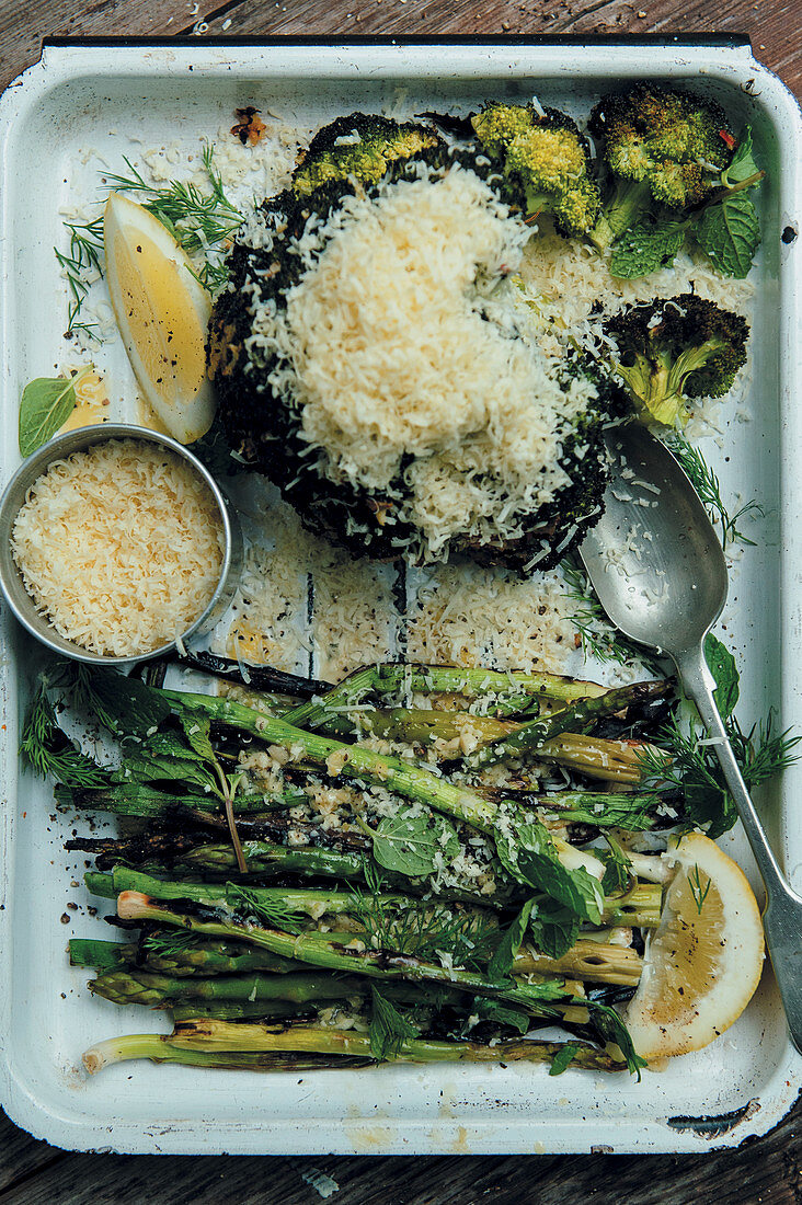 Grilled broccoli and asparaguswith grated cheddar cheese
