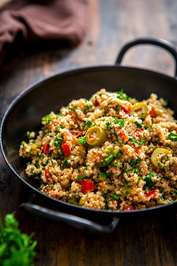 Israeli couscous salad with olives, tomatoes and parsley