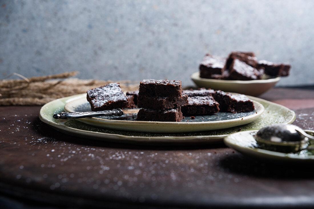 Vegan sweet potato brownies with icing sugar, sliced